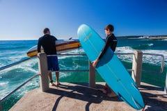 Surfers Pier Jump Ocean Royalty Free Stock Photo