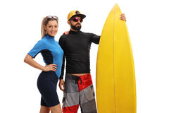Surfers posing with a surfboard. Isolated on white background Stock Photography