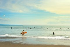 Surfers ready to surf. Bali. CANGGU, BALI ISLAND, INDONESIA - JAN 19, 2017: Surfers going to surf in the ocean. Bali island is one of the worlds best surfing Royalty Free Stock Images