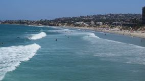 Pacific beach surfers stock video footage