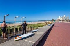 Surfers Showers Beach. Showers and surfers on Durban beachfront promenade Stock Image