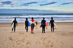 Surfers at Somo Beach (Spain) Royalty Free Stock Photography