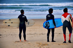 Surfers at Somo Beach (Spain). Young surfers on the beach at Somo Surfer center, Cantabria, Spain royalty free stock photography