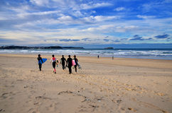 Surfers at Somo Beach (Spain). Young surfers on the beach at Somo Surfer center, Cantabria, Spain stock photography