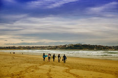 Surfers at Somo Beach (Spain). Young surfers on the beach at Somo Surfer center, Cantabria, Spain stock photo