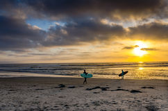 Surfers at Sunset - California Stock Image