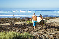 Surfers surf on the waves Royalty Free Stock Photography