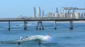 Surfers in Surfers Paradise skyline Gold Coast Australia