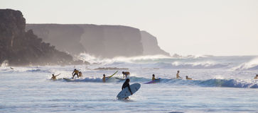Surfers surfing on El Cotillo beach, Fuerteventura, Canary Islands, Spain. Stock Images