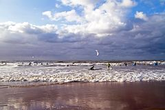 Surfers surfing in the Netherlands Stock Photography