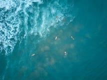 Surfers swim to big wave Royalty Free Stock Photos