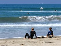 Surfers Take A Rest. Surfers Take A Break In Southern California Stock Photography