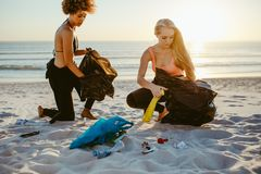Surfers Tidying Up The Beach Stock Photography