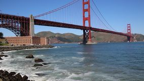 Surfers under Golden Gate Bridge. View at Golden Gate Bridge- California stock video