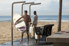 Surfers under the shower, Durban beach Stock Image