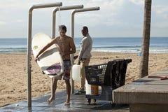 Surfers under the shower, Durban beach Stock Image