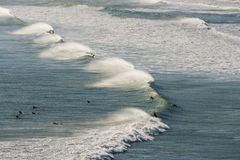 Surfers waiting for wave. Aerial view of surfers waiting for wave Stock Image