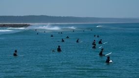 Surfers waiting for Wave and surfing. Portugal , Costa de Caparica Stock Photo