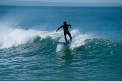 Surfer chased the wave surfing. Surfers waiting for Wave and surfing. Portugal , Costa de Caparica stock images
