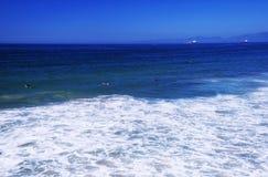 Manhattan beach california summer surfing. Surfers waiting on waves at Manhattan Beach California on the sunny west coast Stock Image
