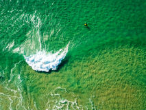Surfers Waiting Waves on the Surface of the Ocean Stock Image