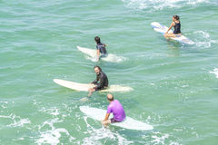 Surfers waiting for waves. Stock Image
