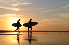 Surfers walking in the beach. Surfer walking on the beach playing and having fun Stock Photo
