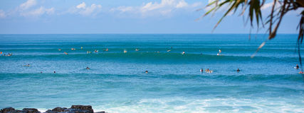 Surfers on a wave in bali 4 Stock Photography