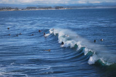 Surfers and Waves. Surfers waiting for the waves at Santa Cruz, California, USA Stock Image