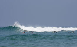 Surfers in the waves of the atlantic ocean Stock Photo