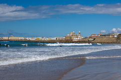 Surfers on the windy beach of Cadiz Stock Photography