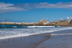 Surfers on the windy beach of Cadiz stock photography