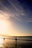 Surfersat Sunset. Two surfers leaving the waterat sunset Royalty Free Stock Photography