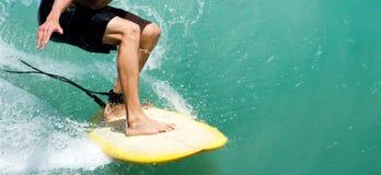Surfersbenen op de raad Royalty-vrije Stock Foto