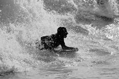 surfin della siluetta Fotografie Stock