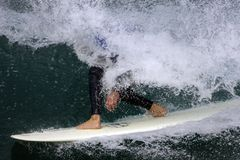 Surfing 003. A surfer is barrelled in a wave Royalty Free Stock Images