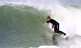 Surfing. Man surfing a nice wave in winter Stock Photos
