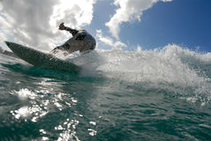 Surfing. A surfer surfing down the line stock photo