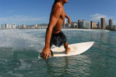 Surfing. Bottom turn on a wave royalty free stock photos