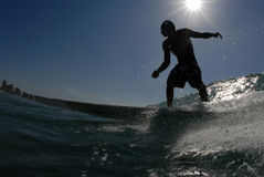 Surfing. A surfer surfing down the line Stock Image