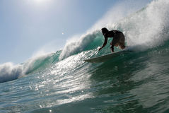 Surfing. A surfer surfing down the line stock images