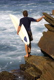Surfing. Surfer wondering if he should be surfing Royalty Free Stock Image
