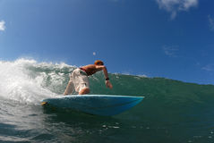Surfing. A teen shortboarder surfing down the line stock photo