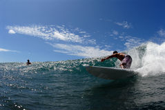 Surfing. A longboarder surfing down the line stock image