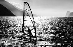The Surfing. Surfing in the evening on the Garda lake,Torbole, Italy Royalty Free Stock Photography