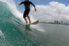Surfing. A shortboard surfer surfing a beautiful wave in hawaii stock photography