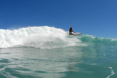 Surfing. A shortboard surfer surfing a beautiful wave in hawaii stock images