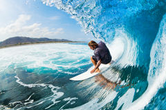 Surfing. Surfer on Blue Ocean Wave in the Tube Getting Barreled Royalty Free Stock Photos