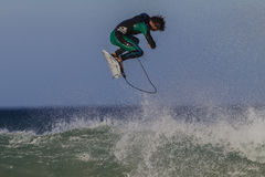 Surfing Air Rider. Surf rider performs a  air spin above wave lip at Jeffreys bay South Africa Stock Photography