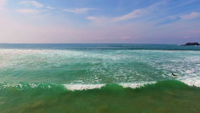 Surfing at Arifana in tbe atlantic ocean in Portugal stock footage